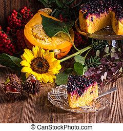 Autumn pumpkin cheesecake with cranberries