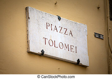 Piazza Tolomei in Siena, Tuscany - The streetsign of Piazza...