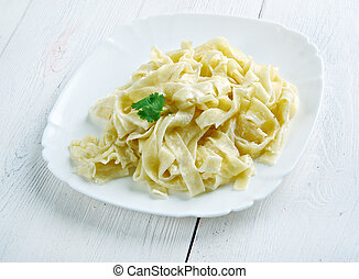 pasta Fettuccine Alfredo with cream close up
