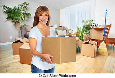Woman with moving box. New house owner.
