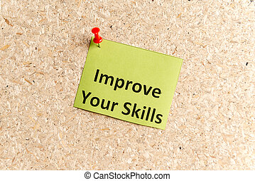 improve your skills word typed on a paper and pinned to a...