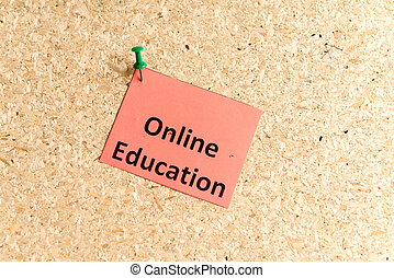 online education word typed on a paper and pinned to a cork...