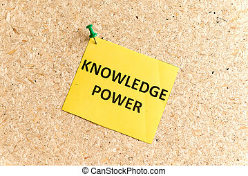 knowledge power word typed on a paper and pinned to a cork...
