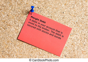 margin debt word typed on a paper and pinned to a cork...