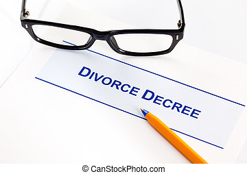 Divorce Decree with glasses and ballpoint pen