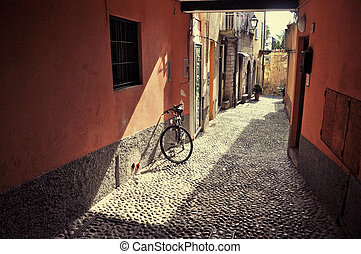 Filtered image of a bicycle on the narrow street of Bellagio...