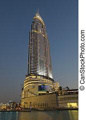 The Address Hotel illuminated at night. Dubai, United Arab Emirates