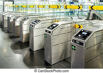 Underground metro station with modern gate ticket machine...