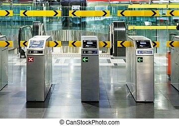 Underground metro station with modern gate ticket machine...