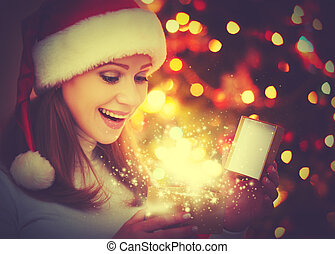 happy woman with magic Christmas  gifts