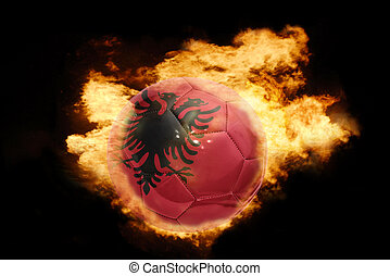 football ball with the flag of albania on fire - football...