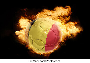 football ball with the flag of belgium on fire - football...
