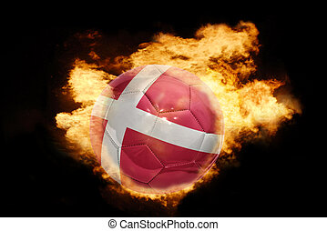 football ball with the flag of denmark on fire - football...