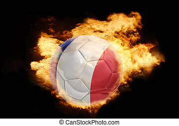 football ball with the flag of france on fire - football...