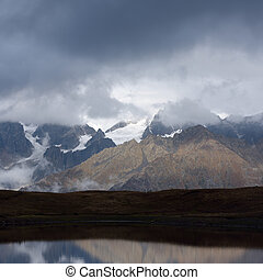Mountain Lake - Landscape with a mountain lake. Cloudy day....