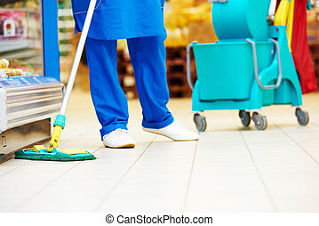 Floor care and cleaning services - Female cleaner worker in...