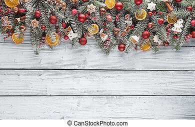 Christmas fir tree with decoration on a wooden board....