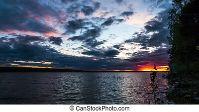 Bright Sunset at Lake Shore - Time Lapse of Bright Sunset at...