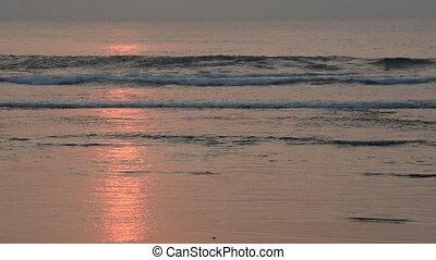 Enjoy calm summer beach waves at sunset