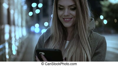 Video of woman walking on tablet