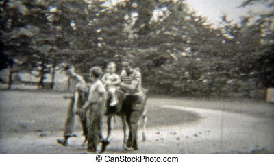 1949: Babys first horse ride with - Vintage 8mm film home...
