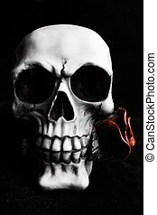 Gothic Skull - A gothic skull holding a rose between its...