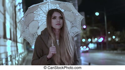 Video of woman with umbrella - Video of a young woman...