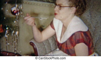 1954: Redhead glasses girl eating - Vintage 8mm film home...