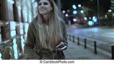 Video of woman walking on phone