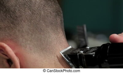 Hairstyling process, barber shaves a man