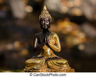 Buddha figure illuminated by the sun - Buddha figure outside...