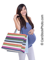Asian Pregnant woman holding paper bag, shopping concept in white background