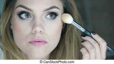 video of woman applying powder - Video of an attractive...