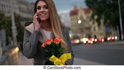 Video of woman holding flowers