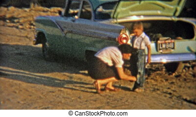 1954: Mom brushing dirt off of dirt - Vintage 8mm film home...