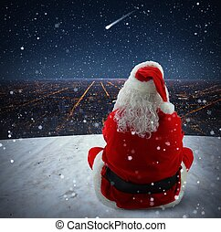 Christmas falling star - Santa Claus watches a sparkling...