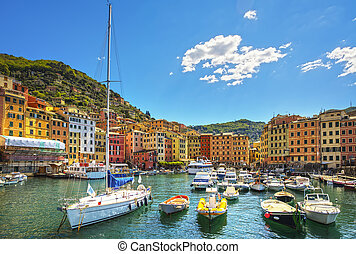 Camogli marina harbor, boats and typical colorful houses...