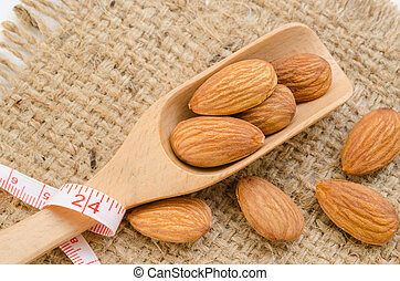 Almond and measuring meter - Almond and measuring meter on...