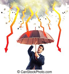 Stormy economic crisis - Businessman sheltered with umbrella...