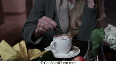 Video of woman drinking cappuccino - Video of an attractive...