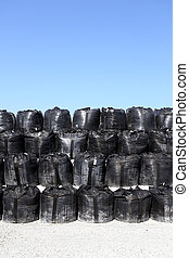 toxic substance bag - stack of toxic substance bag against a...