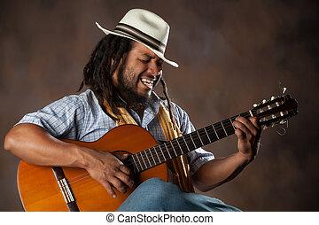 Passionate Afro Man Playing Guitar - Rastafarian Man Playing...
