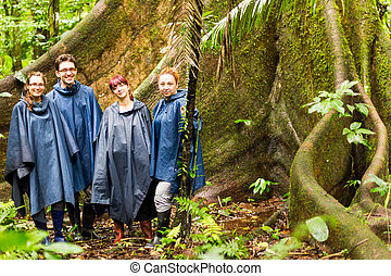 We And The Ceiba Tree - Group Of Four Tourists In Amazonian...