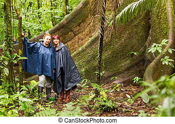 Tourists Sitting Next To A Huge Ceiba Tree Amazon - Group Of...