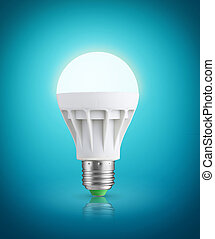 Glowinng LED bulb on blue background