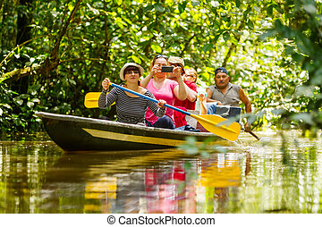 Boat With Tourists In Amazonian Jungle - Tourist Boat...