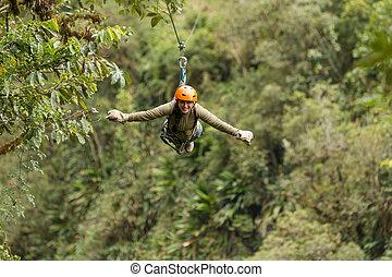 Zip Line Experience - Happy Adult Woman On Zip Line Above...