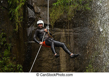 Waterfall Rappelling On Canyoning Adventure - Adult Man...