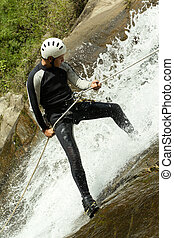 Canyoning Guide Descending A Class Three Waterfall