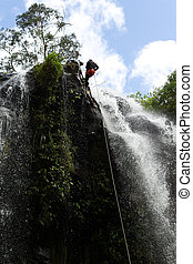 Waterfall Rappelling On Canyoning Adventure - Man Descending...
